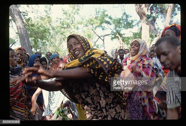 Somali women dance in celebration of the arrival of American troops to help solve the famine and civil war crisis In the 1980s warlord factions...