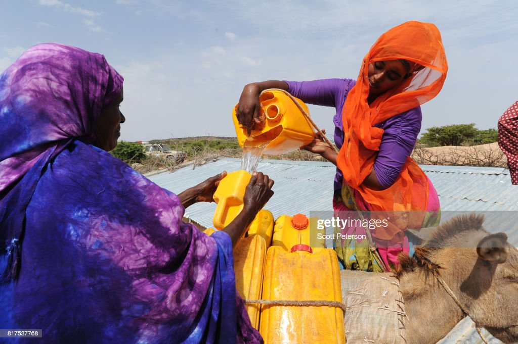 Somali women fill water cans tied to a donkey at a traditional cistern for harvesting rainwater, called a berkad, made by the Irish charity Concern-Worldwide as the Horn of Africa faces severe drought in Carro-Yaambo, a village 20 miles west of the capital Hargeisa, Somalia, on June 21, 2017. The United Nations and NGOs have sought to raise resilience in pastoralist communities that have seen their lifeblood herds of camels, goats and sheep decimated by up to 80 percent, leaving 6.7 million people in need of assistance to avoid famine in Somalia and Somaliland.