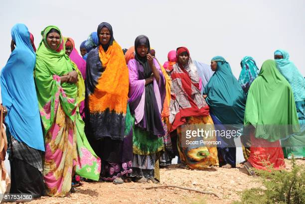 Somali women gather to water their livestock at a traditional cistern for harvesting rainwater called a berkad made by the Irish charity...