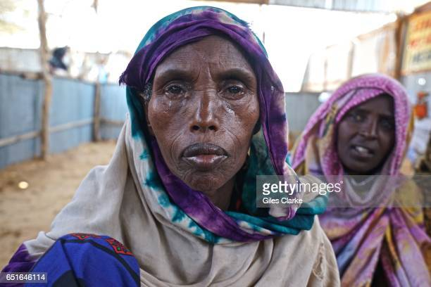 Somali women in tears as she waits to register at a World Food Program registration center in Mogadishu Somalia According to a United Nations...