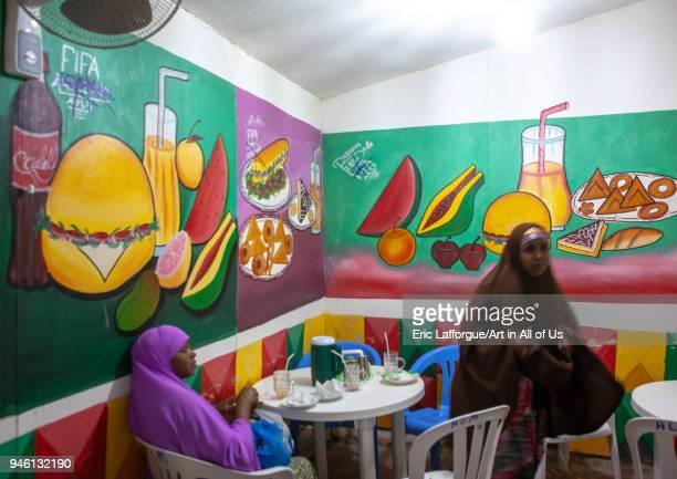 Somali women inside a restaurant with decorated walls Woqooyi Galbeed region Hargeisa Somaliland on November 18 2011 in Hargeisa Somaliland
