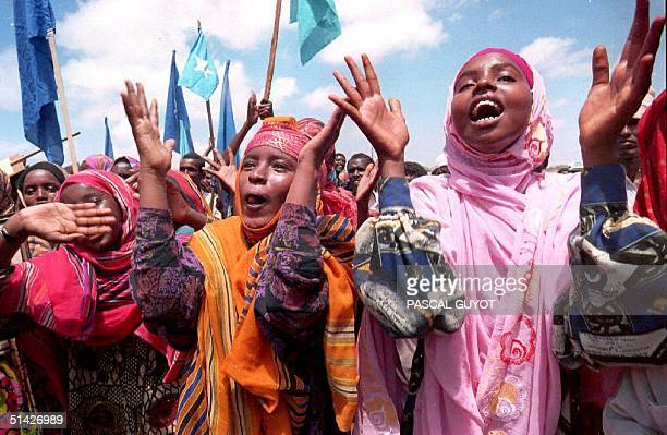 Somali women sing and dance during a demonstration organized by the Somali National Alliance of General Aidid 27 March 1994in Mogadishu Somalia to...