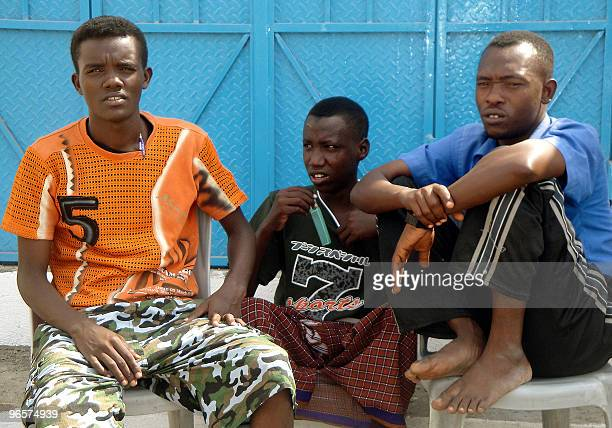 Somali youths sit in the Basateen slum near the Yemeni southern port city of Aden on February 11 2010 Hundreds of thousands of Somali refugees who...