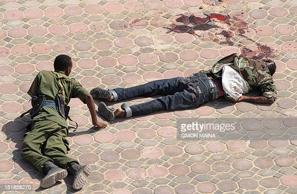 A Somalia bomb expert looks at undetonated body inside the hotel Jazeera compound in Mogadishu on September 12 2012 where the newly elected Somali...
