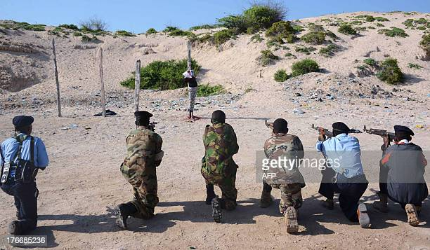 Somalia convicted murderer Adan Sheikh Abdi is executed on August 17 2013 by a firing squad in a Mogadishu square for the September 2012 killing of...
