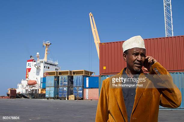 Port manager Ali Omer speaks on the phone at Berbera port in the Somaliland autonomous region of Somalia