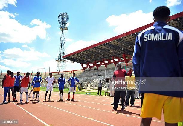 Somalia national football coach Abdi Farah Ali [3rdR] gives instructions to team members of Somalia's national football team during a training...
