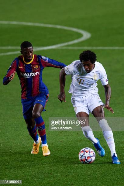 Somalia of Ferencvaros Budapest is challenged by Ousmane Dembele of FC Barcelona during the UEFA Champions League Group G stage match between FC...