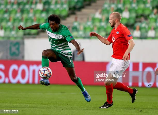Somalia of Ferencvarosi TC and Eirik Hestad of Molde FK in action during the UEFA Champions League Play-Offs Second Leg match between Ferencvarosi TC...