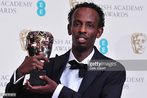 SomaliAmerican actor Barkhad Abdi poses with the award for a supporting actor for his work on the film Captain Phillips at the BAFTA British Academy...