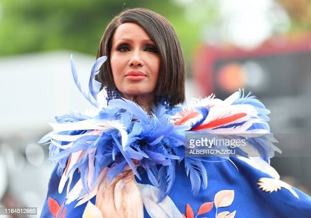 SomaliAmerican fashion model and actress Zara Mohamed Abdulmajid known as Iman poses as she arrives for the opening ceremony and the screening of the...