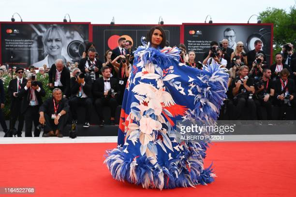TOPSHOT SomaliAmerican fashion model and actress Zara Mohamed Abdulmajid known as Iman poses as she arrives for the opening ceremony and the...