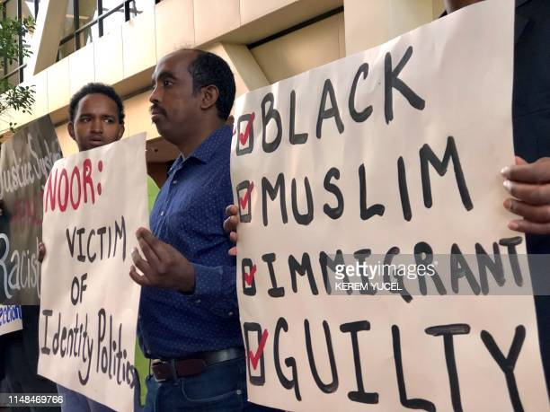 SomaliAmerican supporters rally for former Minneapolis police officer Mohamed Noor at Hennepin County District Court in Minneapolis Minnesota on June...