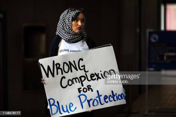 TOPSHOT SomaliAmerican supporters rally for former Minneapolis police officer Mohamed Noor at Hennepin County District Court in Minneapolis Minnesota...