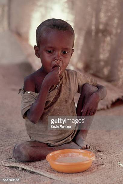 somalian boy eating - malnutrition stock pictures, royalty-free photos & images