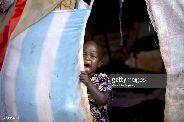 Somalian child cries in a makeshift tent at a camp in Somalia's Bay state on March 29 2017 In the central and south parts of Somalia extreme drought...