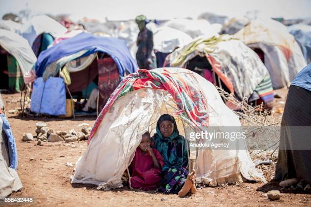 Somalian children sit in their makeshift tent at Balanbaalis camp in Somalia's Bay state on March 27 2017 In the central and south parts of Somalia...