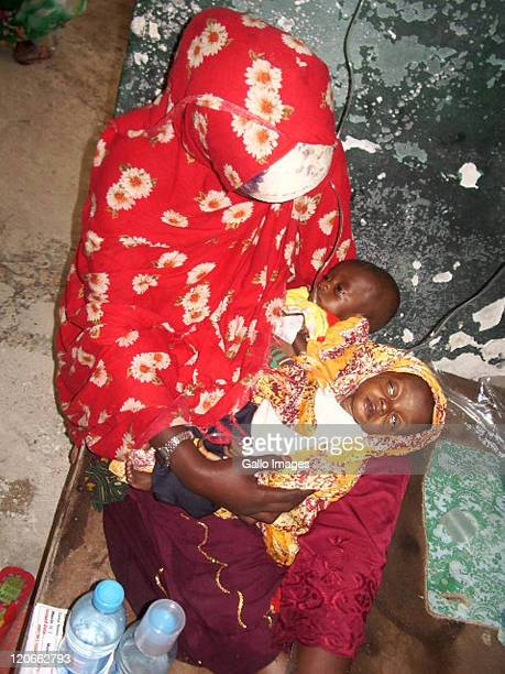A Somalian mother with her sick children at the Gift of Givers makeshift hospital on August 5 2011 in Mogadishu Somalia South African based disaster...