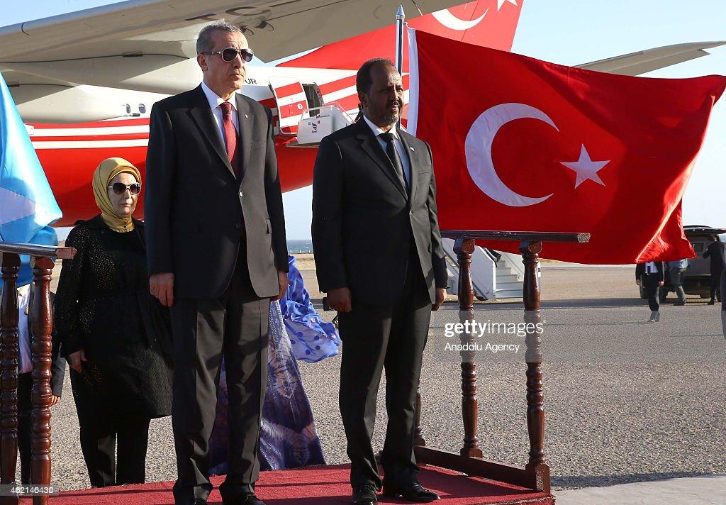 Somalian President Hassan Sheikh Mohamoud (R) bids farewell Turkish President Recep Tayyip Erdogan (front L) in Mogadishu, Somalia on January 25, 2015.
