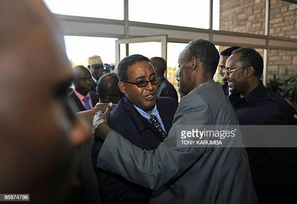 Somalian Prime Minister Omar Abdirashid Sharmarke [2nd L] is embraced by a Somalian member of the cabinet on April 14 2009 at the Jomo Kenyatta...