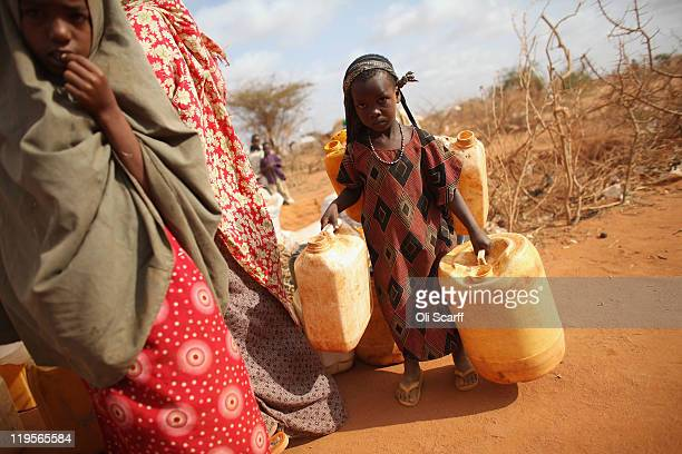 Somalian refugee girl collects water at the edge of the Ifo refugee camp which makes up part of the giant Dadaab refugee settlement on July 22 2011...