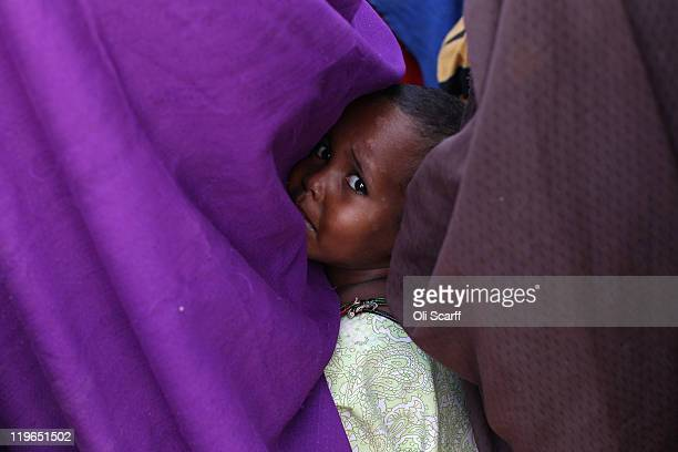 Somalian refugee girl queues in the registration area of the IFO refugee camp which makes up part of the giant Dadaab refugee settlement on July 23...
