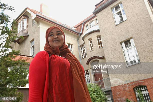 Somalian refugee Raaqiya Maxamud Nuur stands outside of a temporary home providing assistance for refugees on August 5 2015 in Berlin Germany Since...