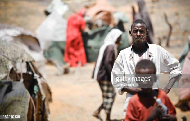 Somalian refugees from the al Shabaab-controlled town of Afgooye make camp on the side of the road on February 20, 2012 in Mogadishu, Somalia. As...