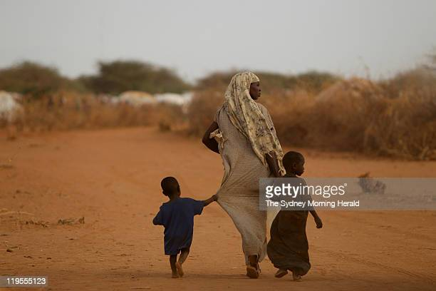 Somalian refugees seek aid after escaping drought and conflict in Somaliaon the outskirts of a refugee camp on July 13 2011 in Dadaab Kenya The first...