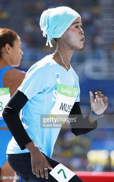 A Somalian runner in warmup wear prepares for a women's 400meter firstround heat at the Rio de Janeiro Olympics on Aug 13 2016