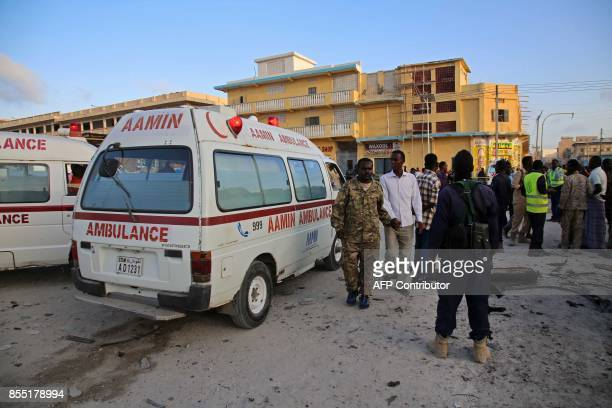 Somalian soldiers and ambulance workers gather at the scene after a car bomb exploded in the centre of Mogadishu on September 28 2017 At least seven...
