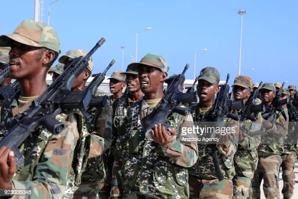 Somalian soldiers march during a military parade in Mogadishu Somalia on February 22 2018