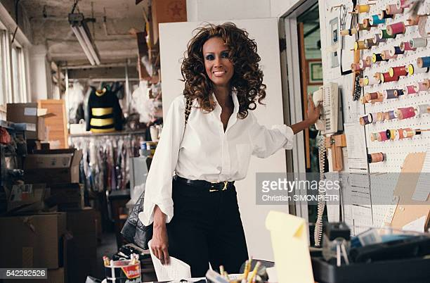 Somalianborn American supermodel Iman wife of British pop star David Bowie in the office of her cosmetics company