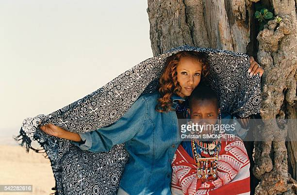 Somalianborn American supermodel Iman wife of British pop star David Bowie with a female member of the Masai tribe in Kenya