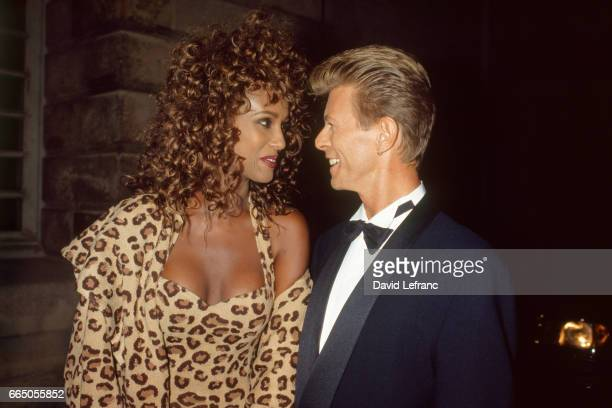 Somalianborn model Iman with husband British singer and songwriter David Bowie at a Bulgari gala at the Orangerie at the Chateau de Versailles