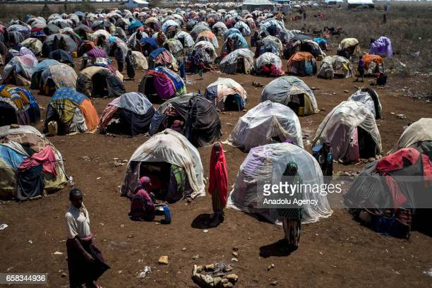 Somalians are seen near their makeshift tents at Dakamur camp in Somalia's Bay state on March 27 2017 In the central and south parts of Somalia...
