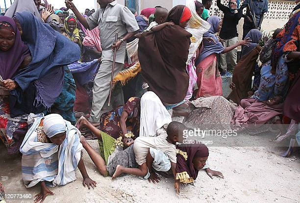 Somalians stampede towards the Gift of Givers makeshift hospital on August 8 2011 in Somalia South African based disaster relief organisation Gift of...