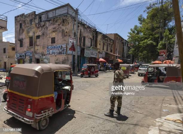 Somalians use auto rickshaws to carry their belongings and to travel through the city in Mogadishu, Somalia on August 05, 2020. The three-wheeled...