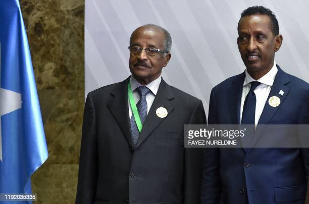 Somalia's Foreign Minister Ahmed Isse Awad and his Eritrean counterpart Osman Saleh Mohammed pose for a picture ahead of a meeting for top diplomats...