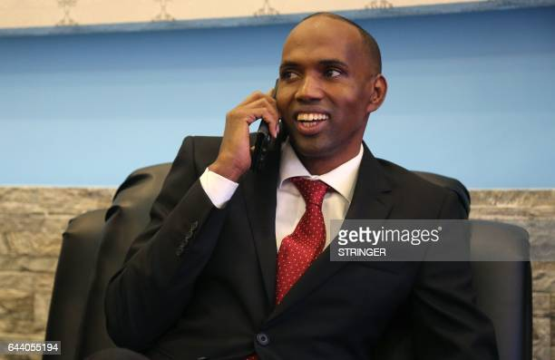 Somalia's newly appointed Prime Minister Hassan Ali Kheyre also spelt Khaire talks on the phone in Mogadishu on February 23 2017 Kheyre a former aid...