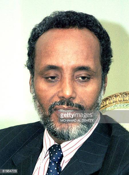 Somalia's newly elected President Abdulkassim Salat Hassan poses for a picture after a meeting with Egyptian Foreign Minister Amr Mussa in Cairo 04...