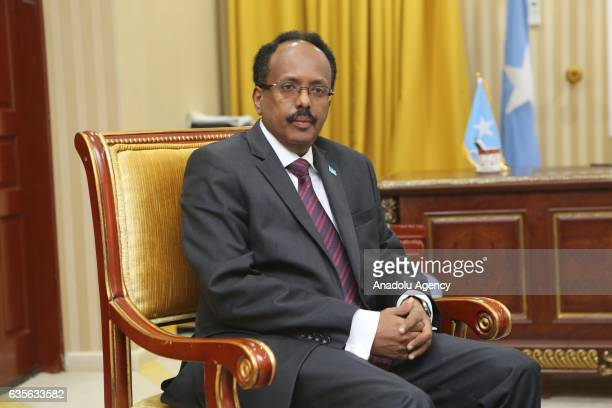 Somalia's newly elected President Mohamed Abdullahi Farmajo and former President Hassan Sheikh Mohamud pose during the presidency handover ceremony...