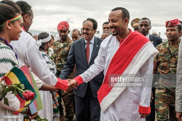 Somalia's president Mohamed Abdullahi Mohamed meets people accompanied by Ethiopia's Prime Minister Abiy Ahmed upon his arrival at the airport in...