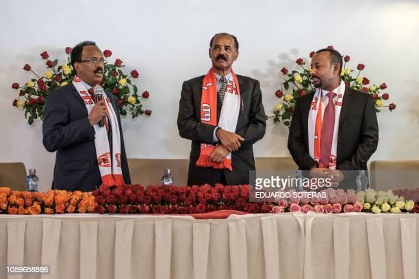 Somalia's President Mohamed Abdullahi Mohamed speaks with Eritrea's President Isaias Afwerki and Ethiopia's Prime Minister Abiy Ahmed during their...