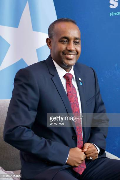Somalia's Prime Minister Mohamed Hussein Roble smiles during his meeting with Britain's Prime Minister Boris Johnson on the second day of the Global...