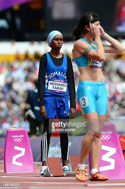 Somalia's Zamzam Mohamed Farah prepares before competing in the women's 400m heats at the athletics event during the London 2012 Olympic Games on...