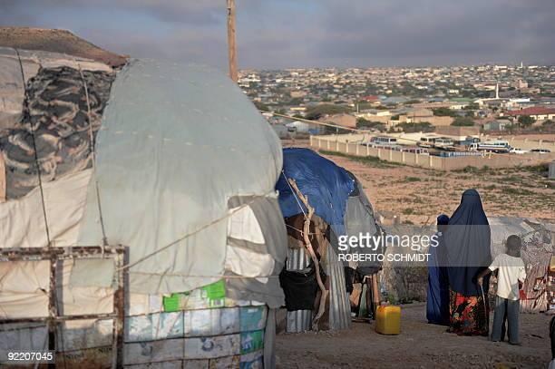 SomaliaunrestdisplacedUN Rapists hunger and hyenas stalk displaced Somali women by Helen Vesperini Halima and her two children stand in front of...