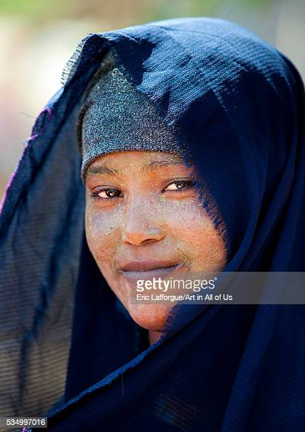 Somaliland Horn Of Africa Hargeisa portrait of a smiling young somali woman with a black veil and qasil on her face