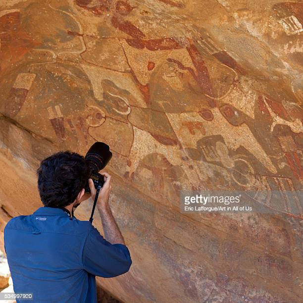 Somaliland Horn Of Africa Laas Geel Site westerner tourist taking pictures of rock art paintings