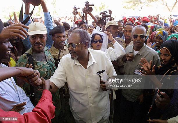 Somaliland president Mohamed Ibrahim Egal shakes hands with voters waiting to cast their ballot at a polling station in Hargeisa Somalia 31 May 2001...